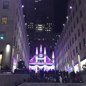 Saks 5th Avenue all lit up and serenading the crowds